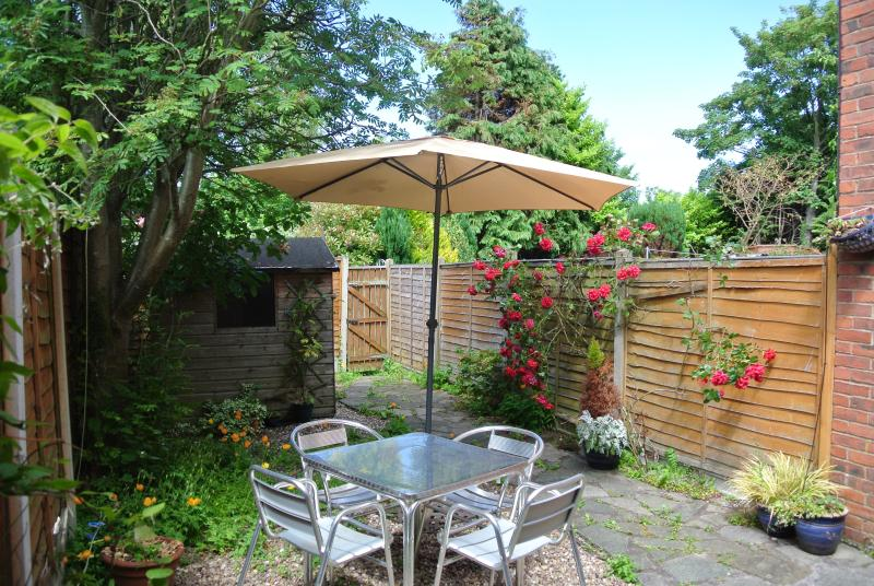 Private Rear Garden with gas barbeque, parasol and garden furniture.