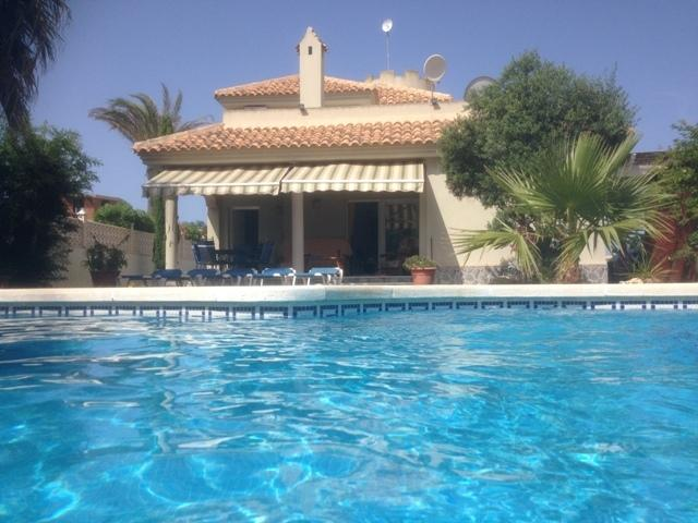 Swimming pool is set in a private garden with a BBQ area