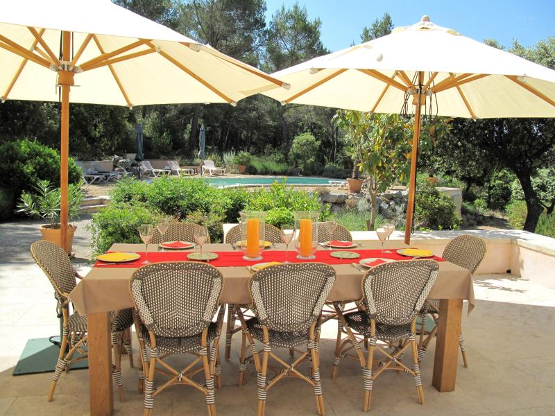 Lovely outdoor dining area with umbrellas for daytime meals or drinks