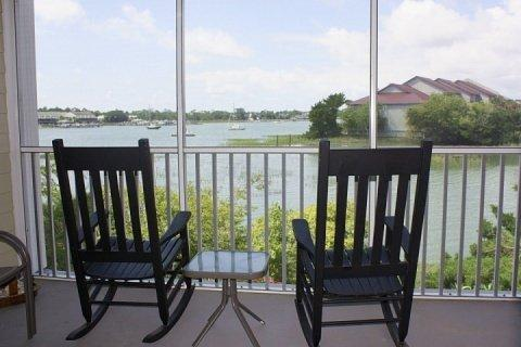 Screened porch for relaxing and catching the breeze