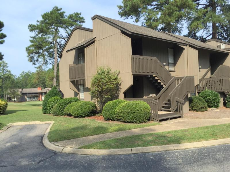 The outside of our first floor end unit condo with a parking space adjacent to the condo.