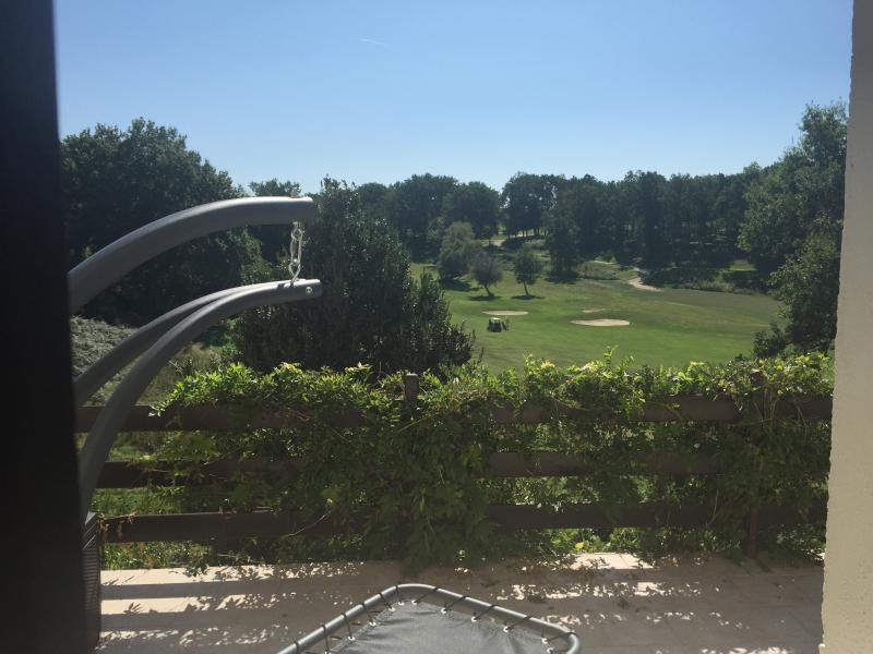 View of Vigiers golf from the large balcony with luxury hammock, swing seat and dining area