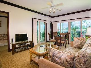Waipouli #B-301: Garden view w/ a sliver of ocean view from the bedroom lanai, Kapaa