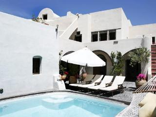 Two spacious, self-contained units with a shared pool. Sensually decorated with hand- picked antiques. VMS MAN, Santorini