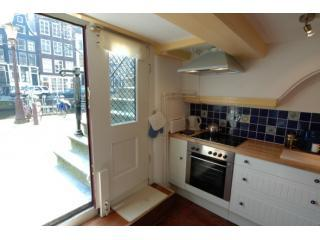 very completly equipped kitchen with doors to canal, copy