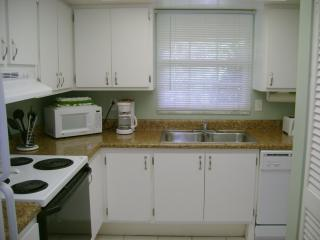 Remodeled full kitchen with refrigerator, range, dishwasher, microwave and washer/dryer