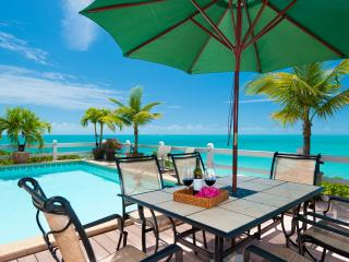 Dine alfresco by your private pool and turquoise ocean
