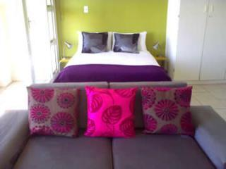 Crisp cotton double bed with modern sleeper couch - ample room for a small family