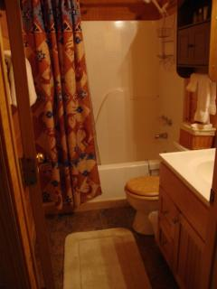 Upstairs full bath, tub with shower