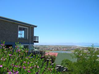 Nestled high up on the mountain with views of the bay, lake and surrounding mountains