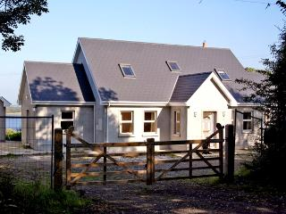 LAKESIDE, pet friendly, country holiday cottage, with a garden in Broadford, County Clare, Ref 2736