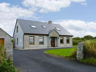 SERENE HOUSE, pet friendly, country holiday cottage, with a garden in Spanish Point, County Clare, Ref 2543