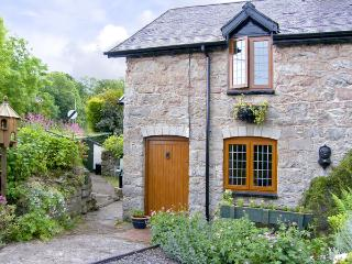 SMITHY COTTAGE, pet friendly, character holiday cottage, with a garden in Graigfechan, Ref 3556, Ruthin