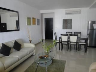 Spacious living room, fully furnished apartment, three blocks from the beach
