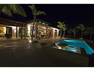 Rear terrace, master suite and pool at night