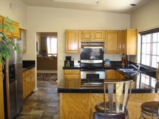 Fully equipped kitchen w/ granite and SS appliances