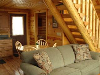 Each cabin is built with real full round logs complete with tasteful and charming interiors.