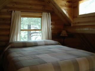 Our loft cabins are furnished with a queen bed complete with stunning views from a trapezoid window.
