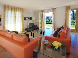 Lounge located in a sunny position with large patio doors