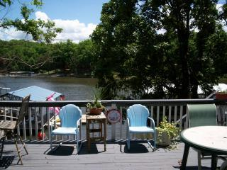 Large sunny deck with Weber Grill and Bar.  Firepit by lake.