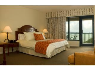 Master bedroom with king bed and beach view