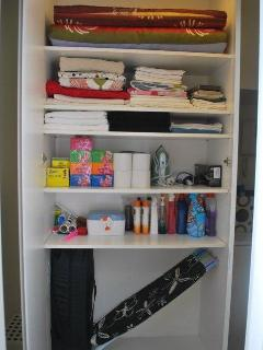 Supplies Cupboard - extra mattress, baby travel cot, spare linen, towels & consumables