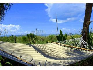 Charming Gulffront 'on the beach' Coquina Cottage and amazing tropical beach gardens., Captiva Island