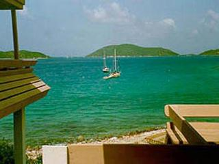 Steps from the water's edge, this villa is tastefully decorated in true Caribbean style. VG BOW, Virgin Gorda