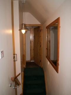 top of stairs looking  left -  towards room with two single beds