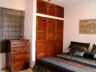 lovely bright and comfortable bedroom with king bed