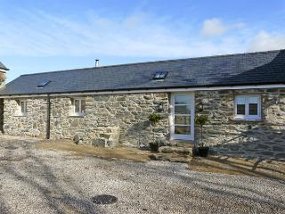 THE STABLES, pet friendly, with open fire in Newborough, Ref 3838
