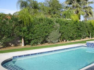 View of pf pool from the outdoor dining area and the living room. So inviting!