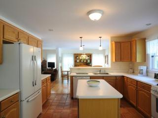 Fully-equipped kitchen features Mexican tile floor, raised eating bar, gas range and breakfast area.