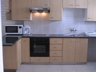 Fully-equipped open plan granite kitchen