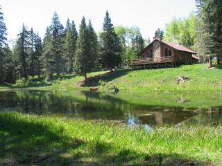 House overlooks spring fed pond with canoe