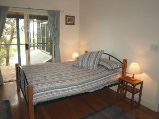 Upstairs Master bedroom with balcony with water view and ensuite