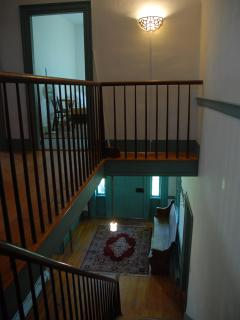 From upstairs bedrms, looking down onto downstairs bedrooms and main front entryway.