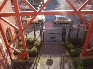 The Leiser's Gated Courtyard Leads To The Locked Entrance
