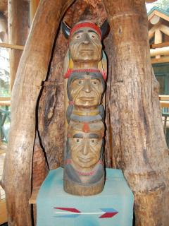 Here, an authentic 1940's Indian totem pole is housed inside a maple tree trunk