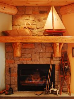 Lower level family room features a gas fireplace and 42 inch flat screen television