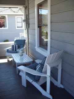 Adirondeck chairs make this porch comfortable