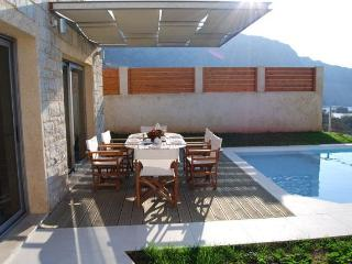 Outside dinning and siting area with amazing sea views of the sparkling blue water