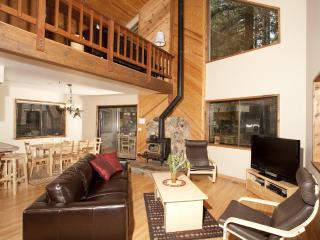 Nestled between the eating area and the entertainment area is a gas fireplace.