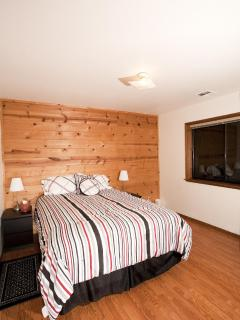 This upstairs bedroom has a queen bed and room for a crib