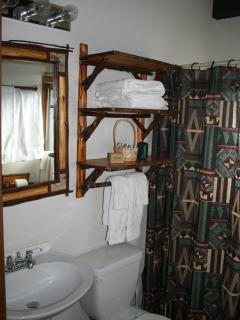 Bathroom with towels, soaps provided