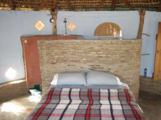 Interior, with bed, shower, toilet and self contained kitchen..