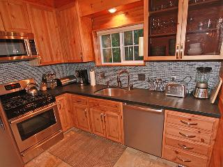 Kitchen w/ stainless steel appliances,black leather brushed granit counter top & everything you need