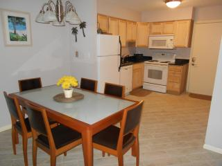 Dining area with view of newly remodeled kitchen.