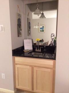 Wet Bar with new cabin and granite countertop.