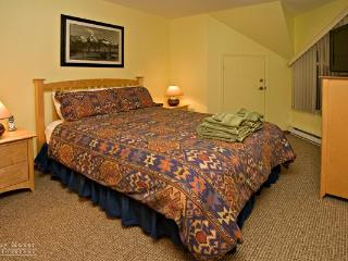 This comfortable master bedroom includes a LCD HD TV with cordless phone.